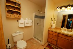 Deluxe bathroom with granite counters and a deep soaking bathtub